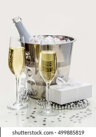 Two champagne glasses, cooler and gift, stylish tinted