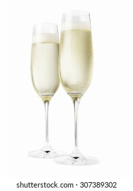 Two champagne glasses isolated on a white background. Please note the chilled nature of the liquid has created condensation on the glasses and it appears they are slightly out of focus.