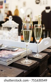 Two champagne glasses on a table
