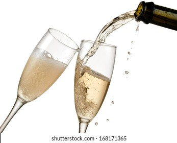 Two champagne glasses pour with drops