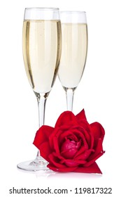 Two champagne glasses and rose. Isolated on white background
