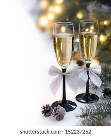 Two champagne glasses with silver bows on new year table