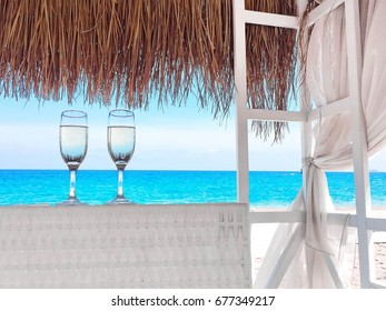 Two champagnes on the beach background