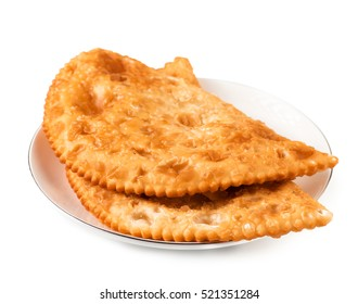 Two Chebureks on white plate isolated with clipping path. Front view. Pasties.