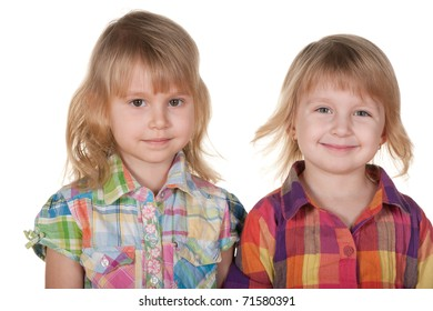 Two cheerful blonde girls in casual; isolated on the white background