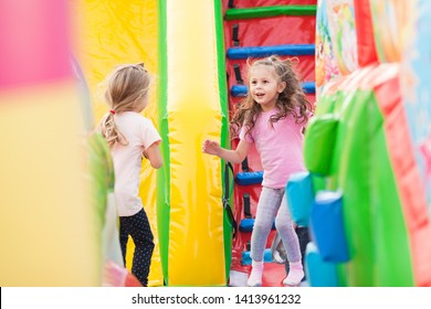 A two cheerful child plays