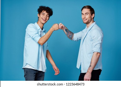 Two cheerful men greet fists