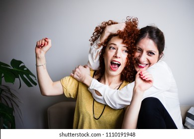 Two cheerful women having fun at home (selective focus)