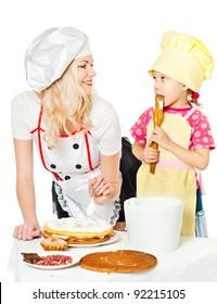 Two chefs rubs cream cake, white background