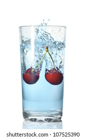 two cherries fell in a glass with water isolated on white