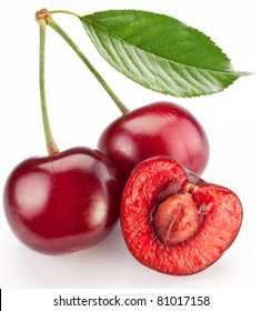 Two cherries and half of cherry isolated on a white background.