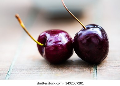 two cherries lying at the table