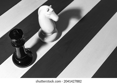 two chess pieces standing in a row, another field, another game. come up with another game