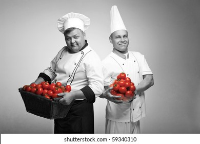 Two chief with tomato