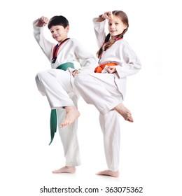 Two children athletes martial art taekwondo training