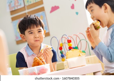two children eating delicious food