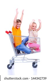 two children - girl and baby - with shopping cart in supermarket