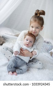 two children. girl of five with brother baby boy of two months. family love