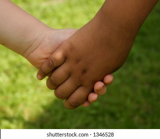 A two children holding hands.