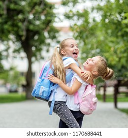 Two children hug and laugh. Square. The concept of school, study, education, friendship childhood