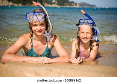 Two children lying on the beach and taken the rest after snorkeling