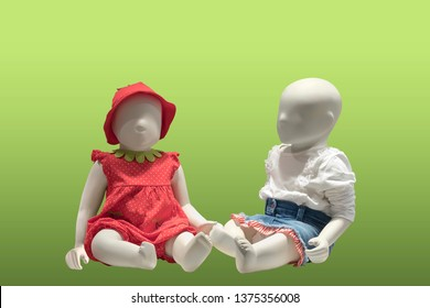 Two children mannequins dressed in a summer style, isolated. No brand names or copyright objects.