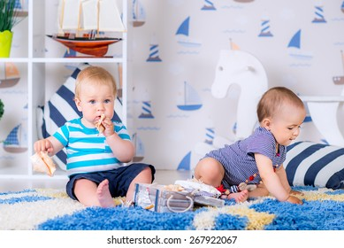 Two children on the carpet in the room with toys