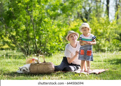 Two children at a picnic in the park