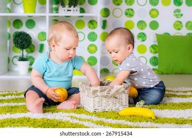 two children playing with a basket of toys