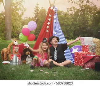 Two children are playing outside dressing up as carnival people laughing at a circus party for an imagination or creativity concept