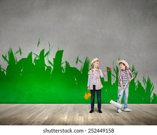 Two children of school age painting wall in colors