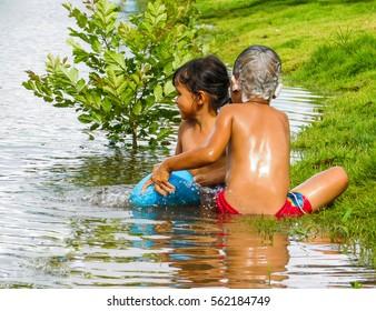 two children shower in river,12,april,2016,chaiyaphum,thailand