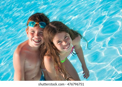 Two children in swimming pool