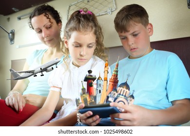Two children with their mother sit on the train and look at the sights of Russia in the phone, collage