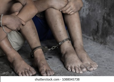 Two children was a victim of human trafficking, foot tied up with shackle, Missing kidnapped, Hostage, human trafficking and violence concept