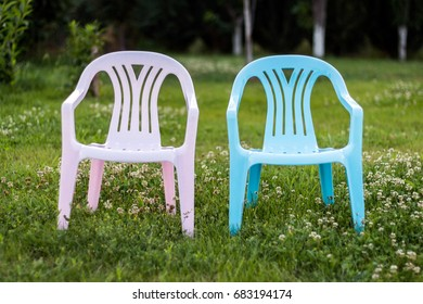 Two children's chairs on grass