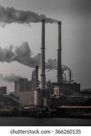 Two chimneys and manufacturing pipe line ind heavy  industry in industrial estate with monochromatic dark look