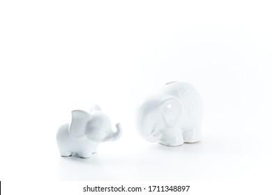 Two china elephants on a white background