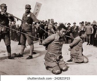 Two Chinese men kneeling prior to execution by Chinese soldiers. The Sino-Japanese war (1937-1945) Fight against the Japanese occupation as well as a civil war between the Nationalists and Communists.