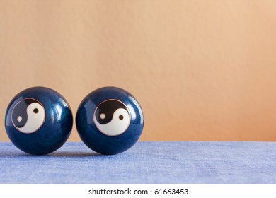 Two chinese yin-yang  balls on a table