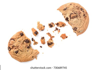 two chocolate chip cookies and crumbs white background