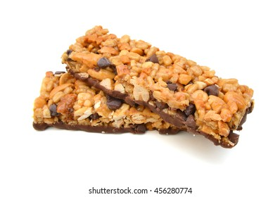 Two chocolate chip with peanuts protein bars isolated on a white background.