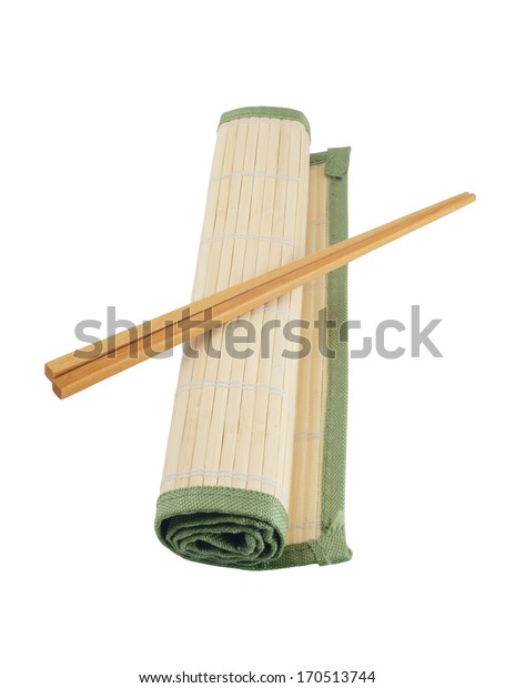 Two chopsticks on bamboo mat