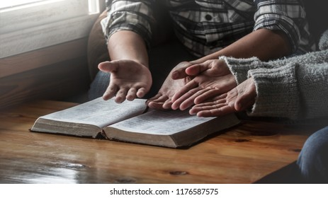 Two christianity sitting with open holy bible and reading