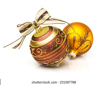 Two Christmas ball. Gold and red isolated on white