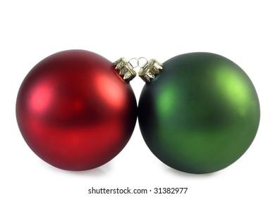 Two christmas balls on bright background. Studio shot.