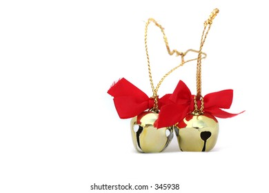 Two Christmas bells isolated on a white background