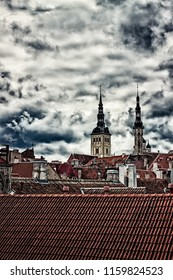 Two church towers rise above the old brick rooftops of the old town of Tallinn, Estonia. The medieval old town is full of this kind of details.