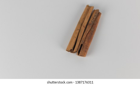 Two cinnamon stick isolated on white background closeup. Top view