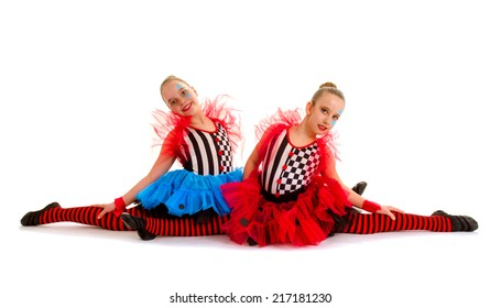 Two Circus Acrobat Dance Children sit in Splits